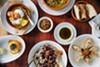 A spread of dishes at Saha, including the lobster <i>knaffe</i> (bottom left), <i>helba</i> & pita (top center), and salmon baklava (bottom right).
