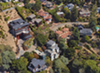 Trees and shrubs grow right up against homes in the Oakland hills. The 1991 firestorm killed 25 people and destroyed $1.5 billion in property, leading to a more rigorous inspection program.