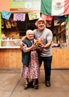 Luis Abundis (right) and his mom hold a sandiloca, the dessert of the summer at Nieves Cinco De Mayo.