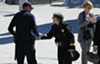 Police Chief Anne Kirkpatrick greets a police officer.