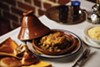 The chicken tajine's golden hue comes from preserved lemon.