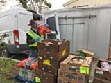 COURTESY FOOD SHIFT - Robert, a food recovery specialist, unloads food.