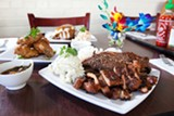 BERT JOHNSON - The tastiest offerings at Kau Kau Corner are the barbecued meats and fried chicken wings.