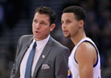 COURTESY OF THE GOLDEN STATE WARRIORS - Interim Head Coach Luke Walton (left) and star guard Stephen Curry have led the Warriors to a record-breaking season.
