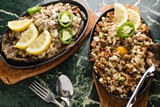 ANDRIA LO - The bangus sisig (left) and pork sisig are served sizzling on hot stone plates.