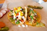 BERT JOHNSON - Two carne molida tacos — the one on the left is topped with mango pico de gallo.Bert Johnson