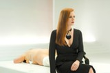 Amy Adams, up all night with bubbly drinks — and butts — in Nocturnal Animals.