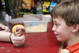 H. GRAPH MASSARA - Dominic Faso, six, meets a leopard gecko at Vivarium in Berkeley.