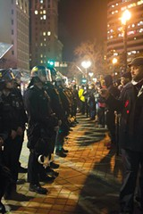 MATTHEW FONG - Law-enforcement officers prevent activists from leaving Frank Ogawa Plaza on Friday night.