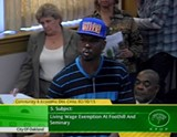 Video still from a public hearing last week about the minimum wage waiver.