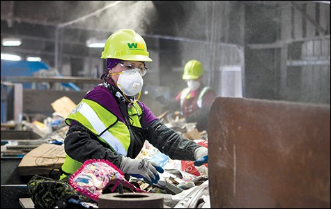 Waste Management worker in San Leandro. - STEPHEN LOEWINSOHN/FILE PHOTO