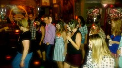 Country line dancing at McTeague's Saloon (via Facebook)