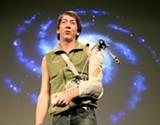 FLICKR.COM/PHOTOS/JURVETSON/ - Will Wright demos Spore at a trade show.
