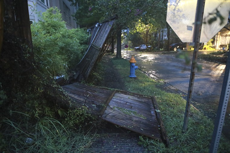 A broken house gate was found in Camp Logan. A lot of residents woke up to downed fences Tuesday morning. - PHOTO BY REGGIE MATHALONE