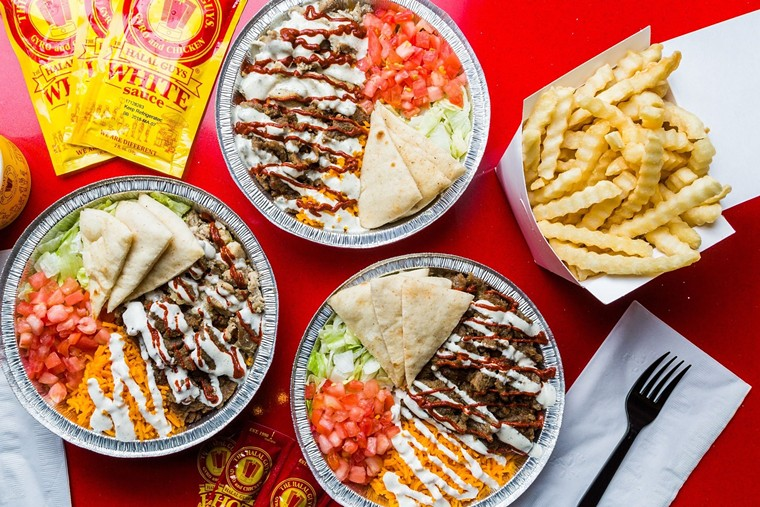 Combo platters can be topped with white or hot sauce, or both. - PHOTO BY THE HALAL GUYS