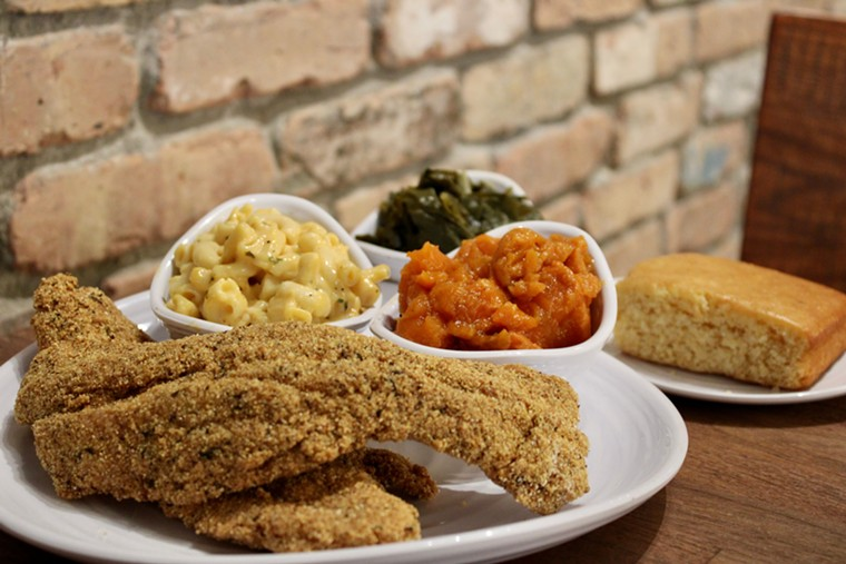 Fried catfish takes its place among home-cooked sides. - PHOTO BY ESTHER'S CAJUN CAFE