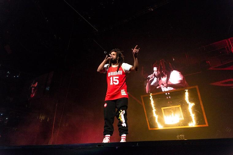 "J. Cole at Toyota Center, sporting a ""Dreamer"" jersey. - PHOTO BY JENNIFER LAKE"