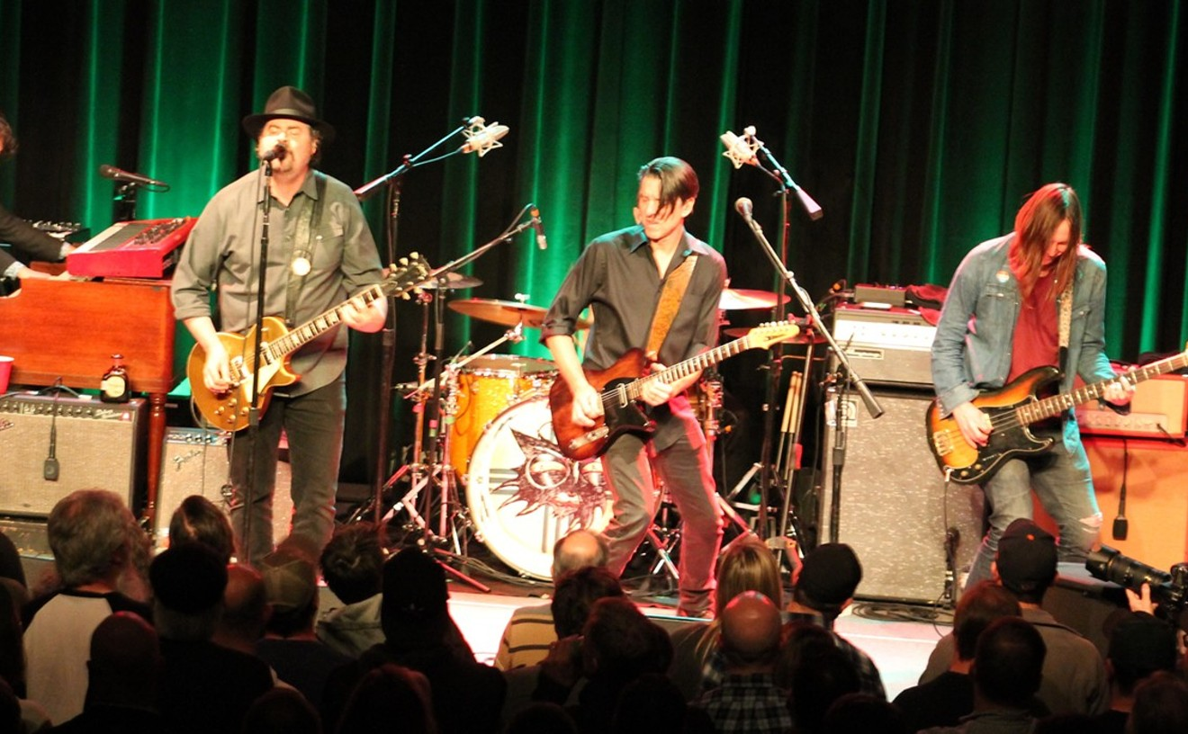 The Drive-By Truckers during their last Houston appearance in November 2019: Jay Gonzalez, Patterson Hood, Mike Cooley, and Matt Patton. Drummer Brad Morgan is hidden.