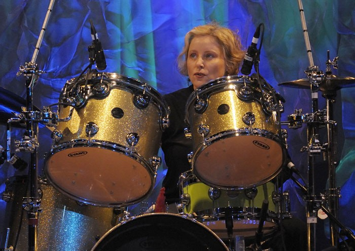 Gina Schock onstage with the Go-Go's in recent years.