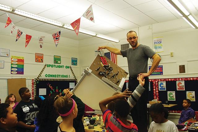Dubois Elementary teacher Dan Hartman demonstrates gravity using a wheel and axle.