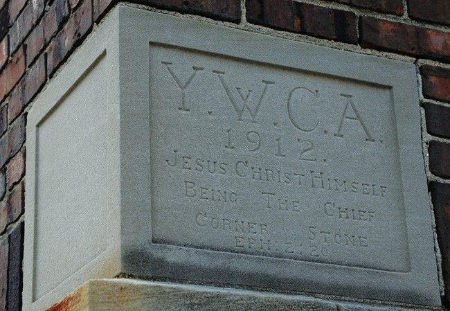 The YMCA cornerstone. - PHOTO BY PATRICK YEAGLE