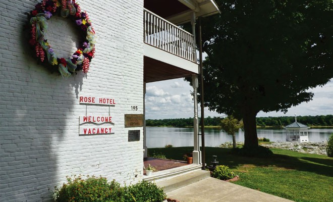 Visitors to Elizabethtown in far southeastern Illinois can watch the Ohio River roll by at the Rose Hotel, an inn built in 1812 and now owned by the state of Illinois. The hotel features five rooms and wide porches on both the first and second floors. - PHOTO BY BRENT BOHLEN