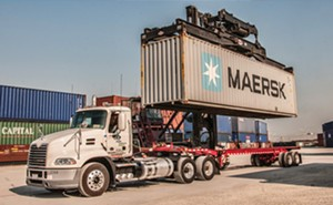 A crane capable of lifting 120,000 pounds unloads a shipping container from a truck at ADM's Intermodal Ramp, part of the Midwest Inland Port in Decatur. - PHOTO COURTESY ADM