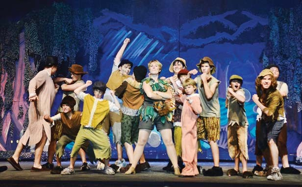 "Peter (Anna Bussing) and the Lost Boys sing ""I Won't Grow Up."" - PHOTO BY DONNA LOUNSBERRY"