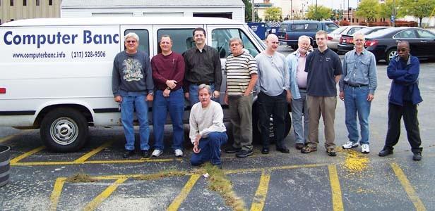 Computer Banc volunteers standing, left to right: Mike Fahsl, Bob Pietras, Lou Gianasi, David Rowell, Cody Colburn, Jim Suttie, Matt Hagaman, Ron Hagaman and Dwayne D. Coleman. Kneeling is Fred Carter. - PHOTO BY ERICKA HINE