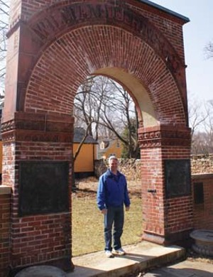 St. James Farms manager Wayne Zaininger beneath the archway from the old William Deering and Company facility.