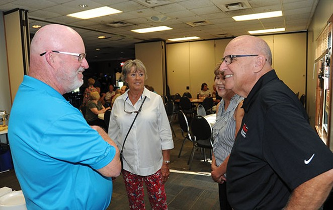 Mike Murphy, right, talks to Phil Gonet at an Aug. 21 campaign fundraiser in Springfield. - PHOTO BY DAVID BLANCHETTE