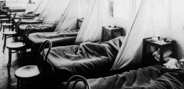 Influenza patients lie on cots at the U.S. Army Camp Hospital #45, Aix-les-Bains, France during the 1918 Spanish influenza outbreak. - PHOTO BY NATIONAL LIBRARY OF MEDICINE