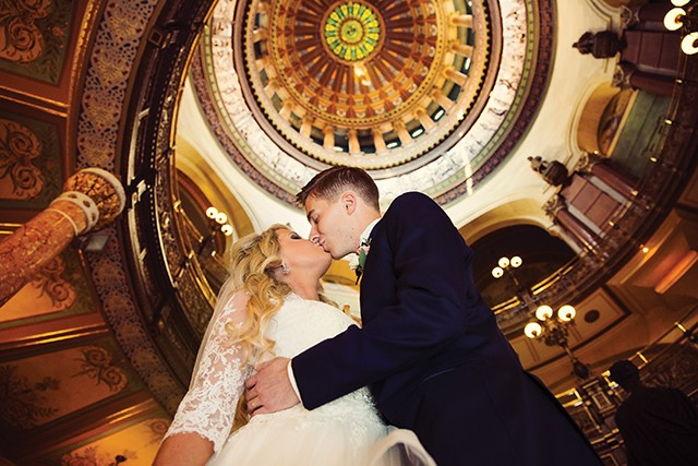 Laura and Ryan Timoney inside the State Capitol. - PHOTO BY MATT DEBACKERE PHOTOGRAPHY
