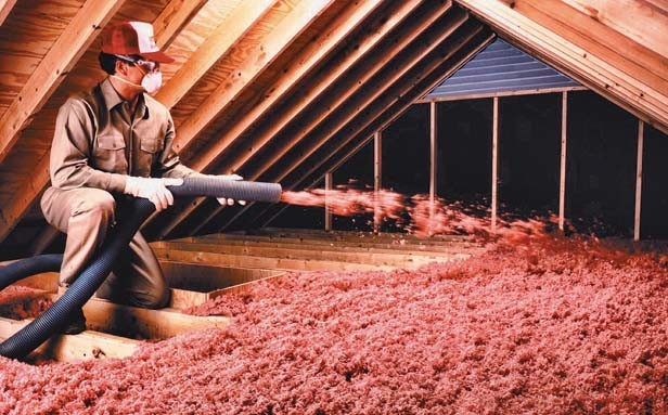 A foot-thick layer of insulation in the attic helps retain cool air in the house while serving as a barrier to heat from the roof.
