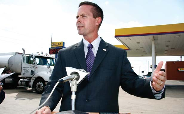 "Republican Rodney Davis speaks to reporters about his ""all of the above"" energy policy at a gas station on the west side of Springfield. Illinois Action Now later protested one of Davis' fundraiser events, saying that"