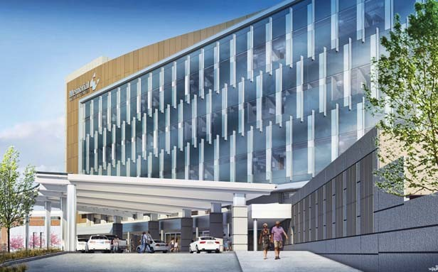 An artist's rendering shows Memorial Medical Center's future patient tower addition, which will face south toward Miller Street. The covered entrance will be an update to the current entrance shown in the photo at right. - COURTESY OF BSA LIFE STRUCTURES