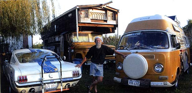 Bob with his beloved vehicles, including the school bus in which he now lives, and his 1972 Volkswagen van, which will go on permanent display at the Rt. 66 museum in Tulsa.