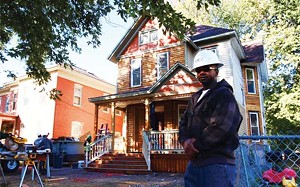 Calvin Pitts, a professional electrician and construction manager, purchased this home on North Fifth Street from Enos Park Development. He and his wife will live there once restoration is completed. - PHOTO BY DAVID HINE