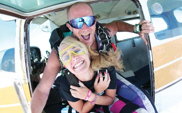 Veteran instructor Brian Meade goes tandem with Emily Eckhoff on her first jump. - PHOTOS BY GREGORY PALMER