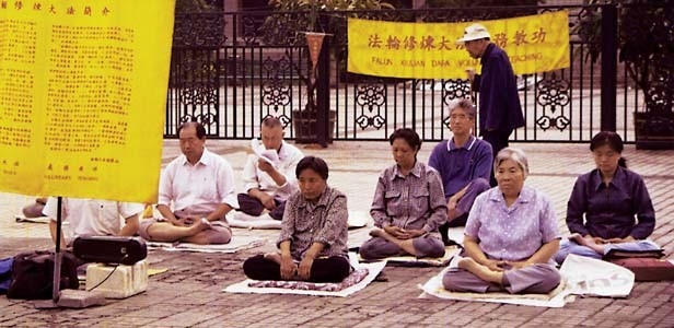 Falun Gong practitioners meditate early one morning in June, 1999, prior to the government crackdown, in front of an art museum in Beijing, China. - PHOTOS BY HILARY SMITH /MCT