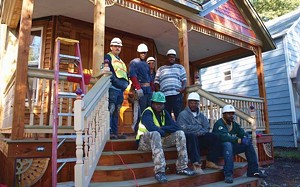 Men from the Urban League's Male Involvement Program are getting construction training while rehabbing this home on North Fifth Street in the Enos Park neighborhood. Back row, from left to right, are Joseph Yeley, Montrell Isom, Troy Sullivan and S - PHOTO BY DAVID HINE