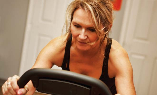 Becky Glazier is working up a sweat at one of the many SpinZone Classes. - PHOTO COURTESY SPINZONE