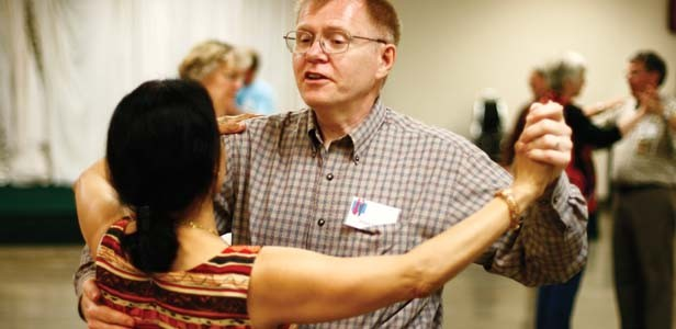 Assistant Steve Harris dances with a student. - PHOTOS BY PATRICK YEAGLE