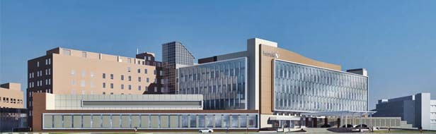 This rendering shows how Memorial Medical Center will look once the new surgical wing (the long, flat building) and patient tower (at right) are completed. They will overlook Miller Street. - COURTESY OF BSA LIFE STRUCTURES