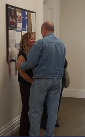 Ashley Clement shares a moment with her uncle Lucky Phillips after gaining custody of her niece Sidney.