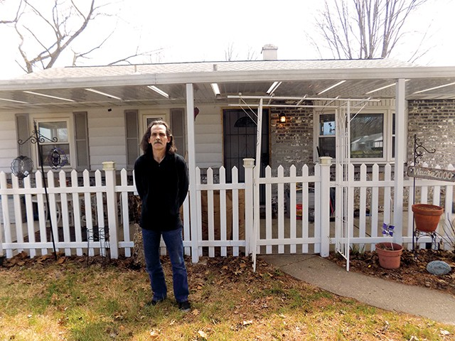 Todd W. Hodges stands in front of his home on Black Avenue. - PHOTO BY BRUCE RUSHTON