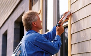 Wood paneling on doors and windows should be caulked to seal in leaks that can let cold air through.