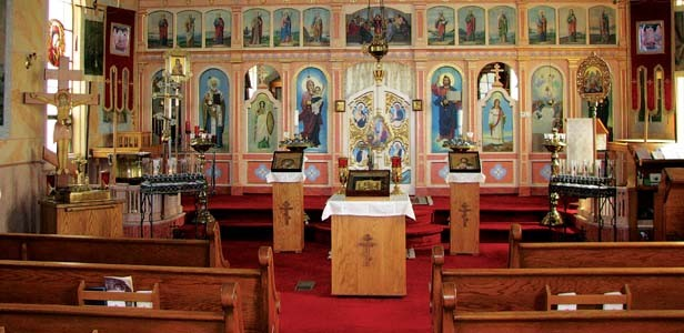 The iconostasis (icon stand) at Holy Dormition Church in Benld, 60 miles south of Springfield. The iconostasis separates the altar from the nave in most Orthodox churches. - PHOTOS BY WILLIAM FURRY