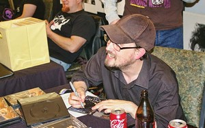 Jones signs DVDs for fans who keep up with his antics via the Internet. - PHOTO BY BRUCE RUSHTON
