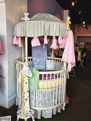 A baby bed in one of the shops in the Third Street area. - PHOTO BY CINDY LADAGE